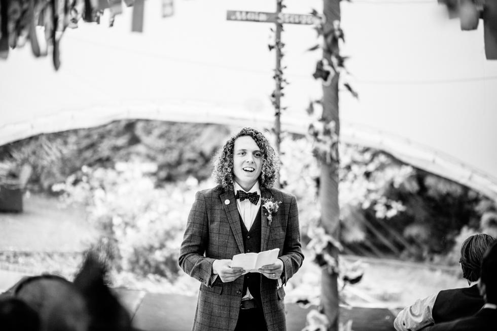groom doing emotional speech at his outdoor wedding reception