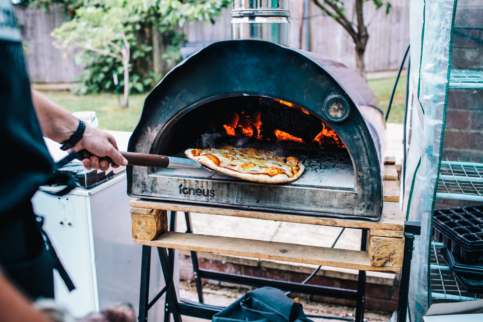 wood fired pizza for wedding food at festival wedding