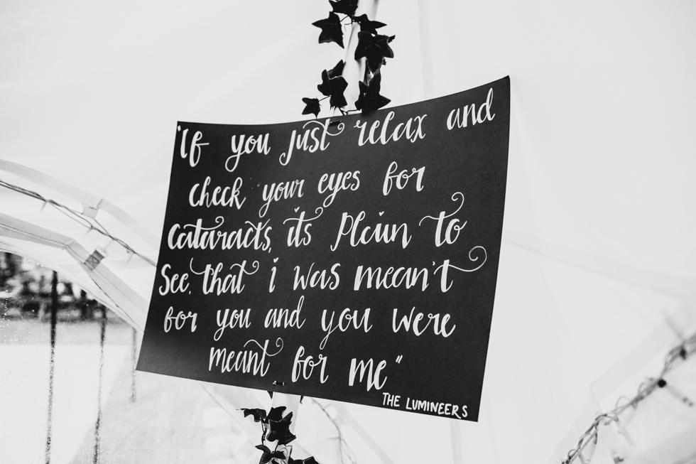 song lyrics as decorations at festival wedding