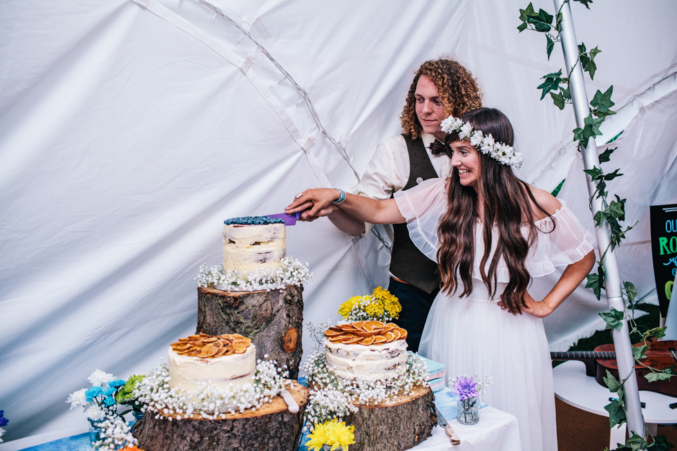 bride and groom cutting their home made cakes