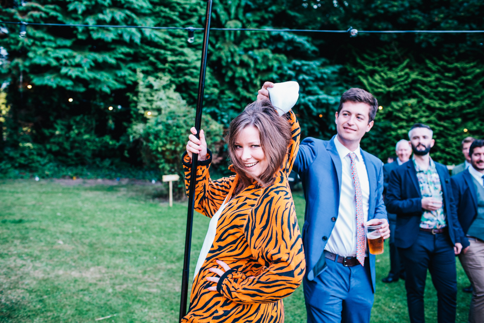 wedding guest dancing in tiger onesie