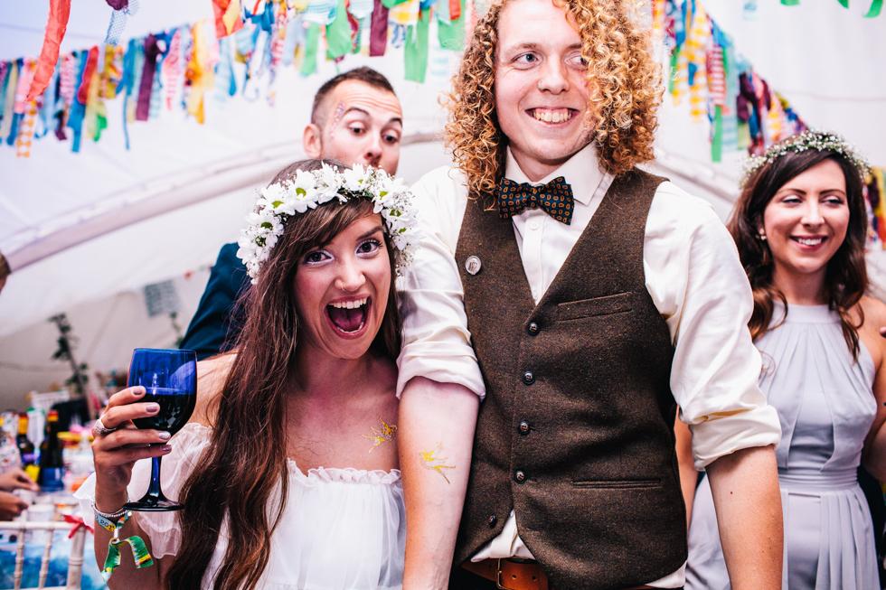 bride and groom wearing temporary wedding tattoos