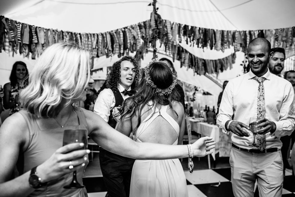 bohemian bride and groom first dance at the main stage Glastonbury style wedding