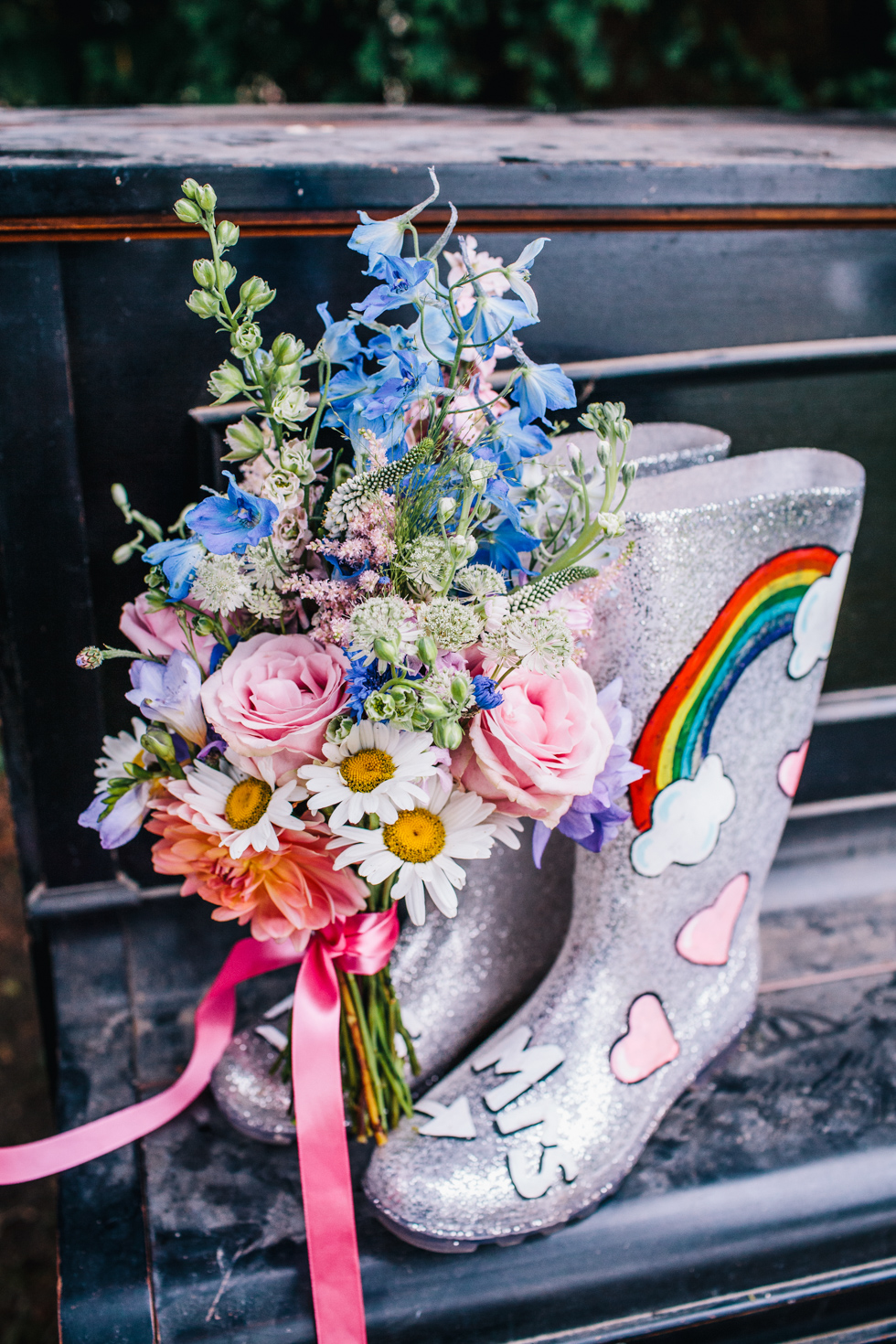 wedding wellington boots with a unicorn and rainbows drawn onto the side