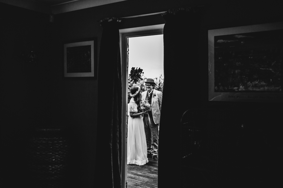 bride and her dad talking outside before wedding