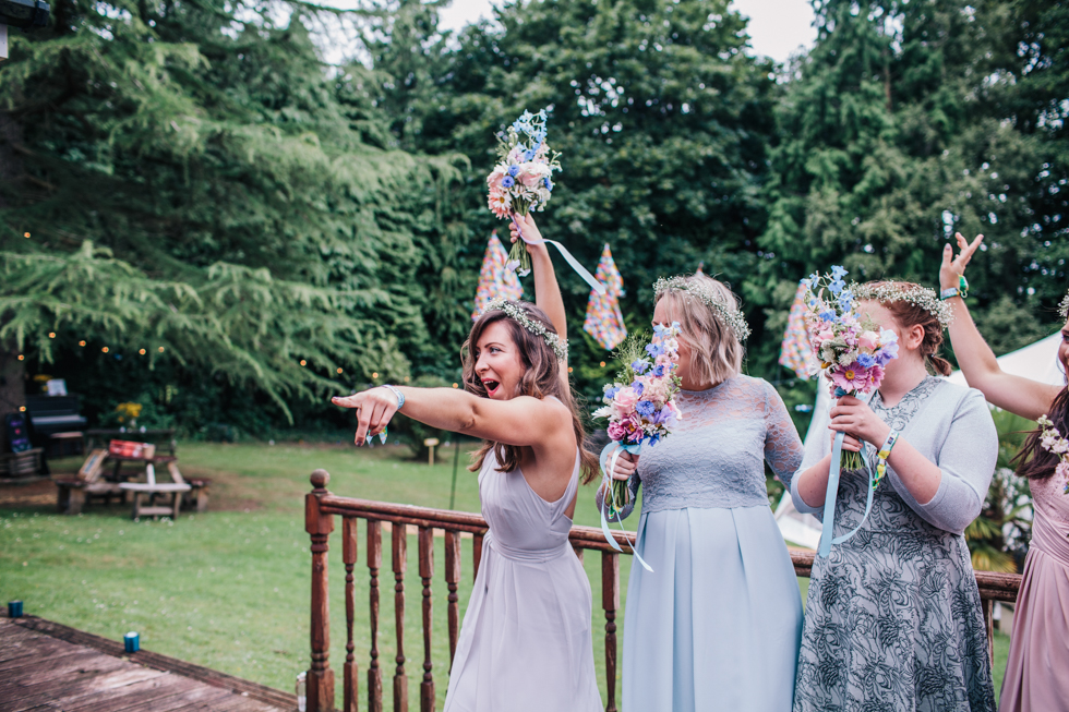 bridesmaid getting excited and dancing with other bridesmaids