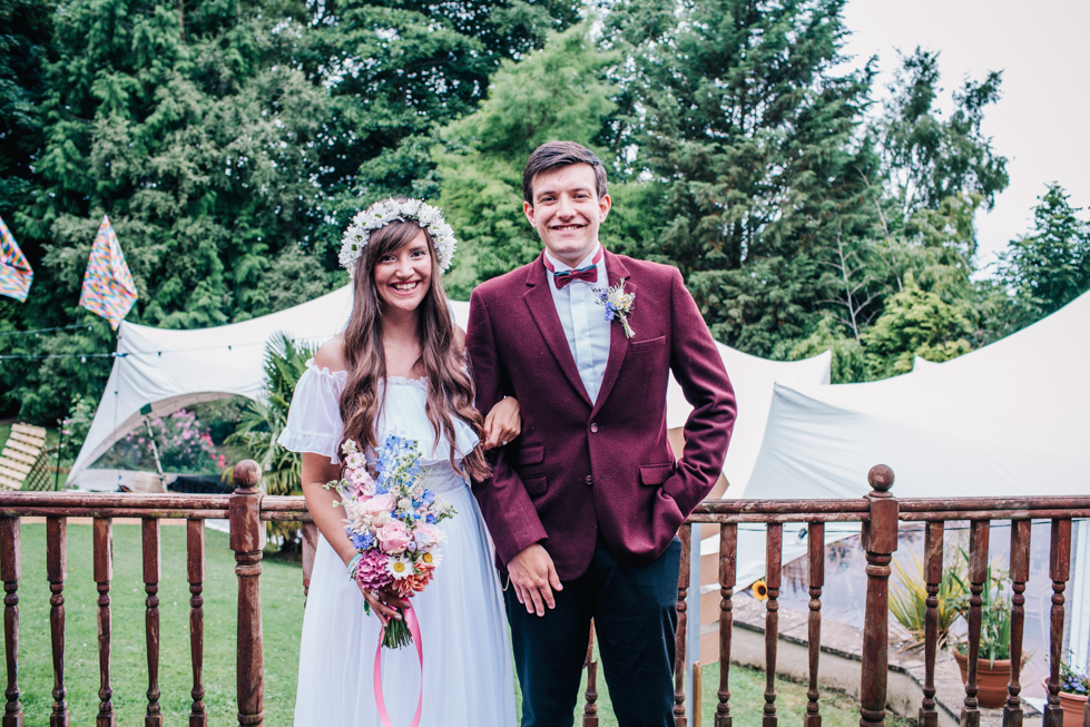 bride in 1970's beautiful charity wedding dress next to brother wearing maroon dinners suit and bowtie