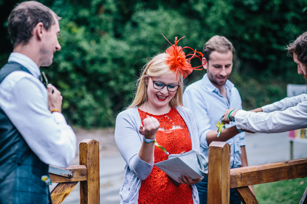 wrist bands at festival wedding for guests to wear