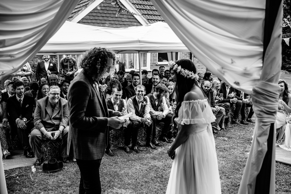 bride and groom at outdoor ceremony with brother as humanist celebrant