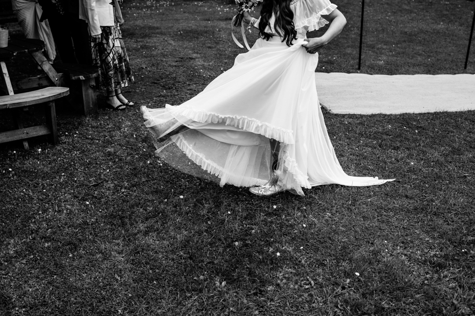 bride showing her wellington boots off