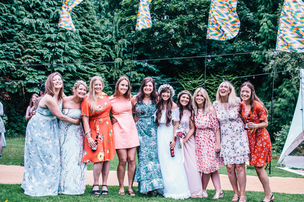 large group shot of friends outside at home-made festival wedding