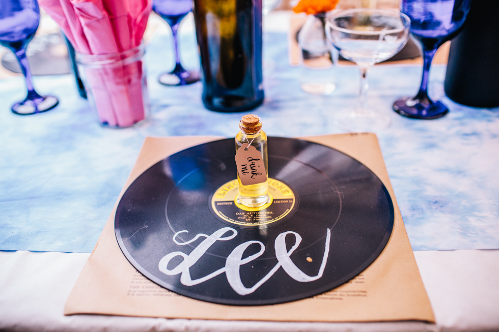 hand drawn calligraphy on vinyl records for place names at festival wedding