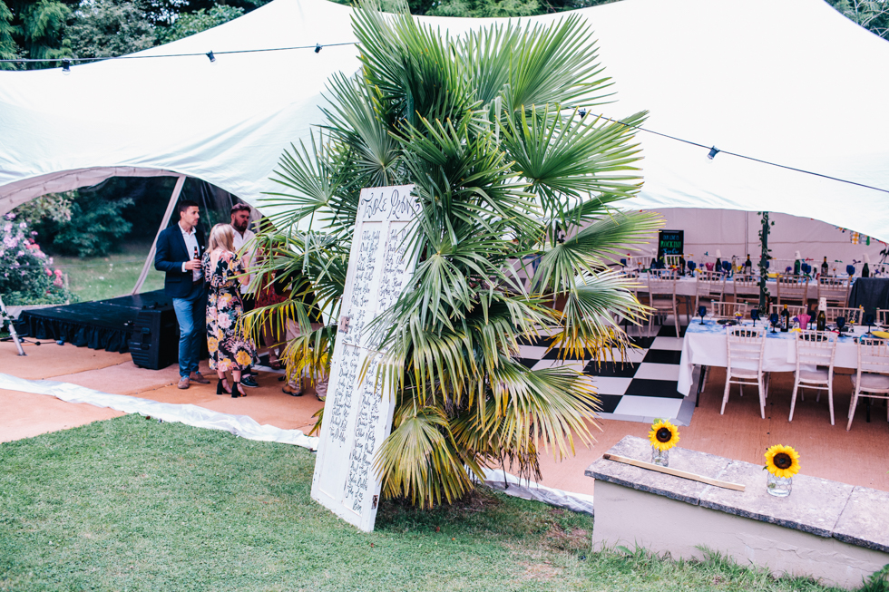 wide shot of tent at festival wedding