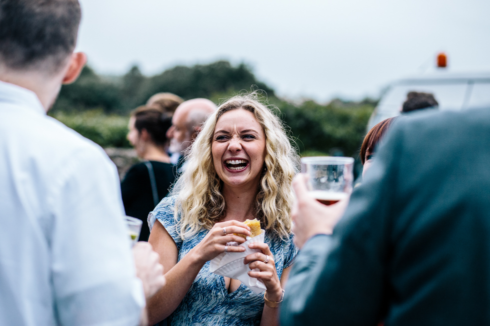 blonde girl eating freshly made crepes at walled garden Mells