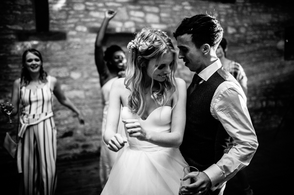 bride and groom dancing closely to Beyonce at Mells Walled Garden