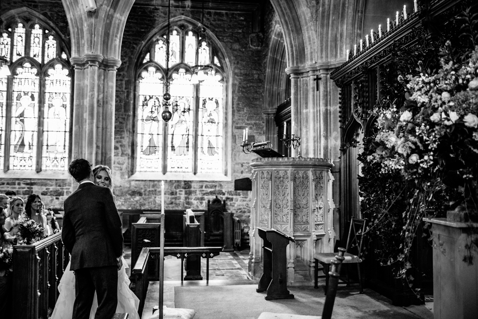 groom chatting to bride at alter just after getting married