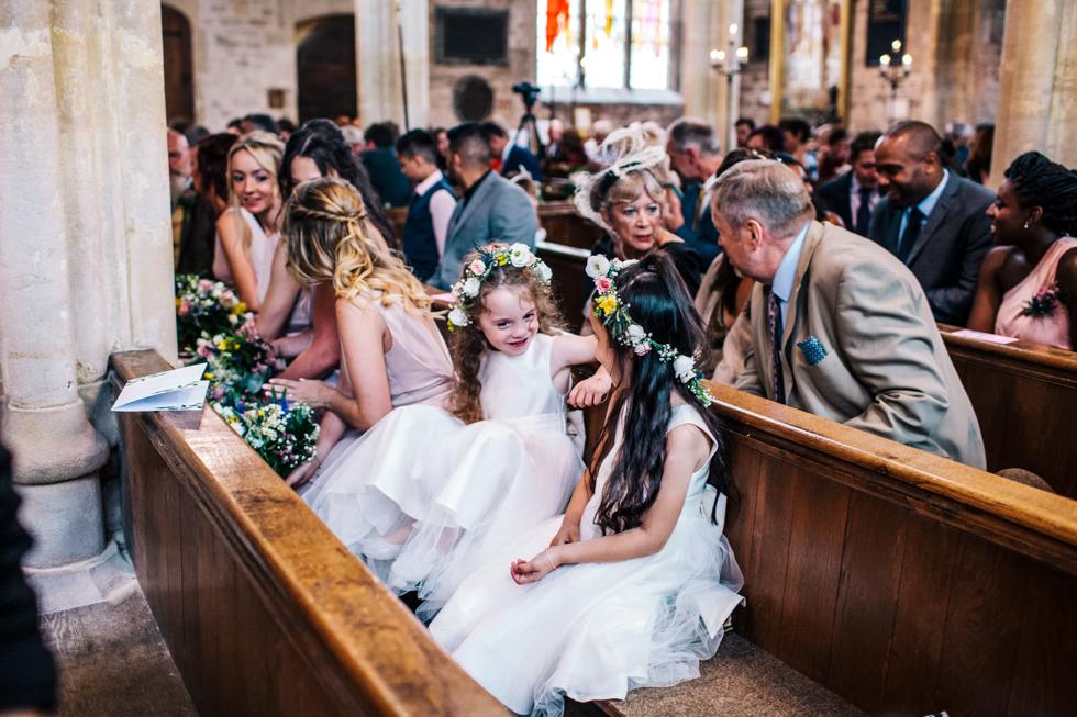 flower girls giggling in St.Andrews Church during wedding