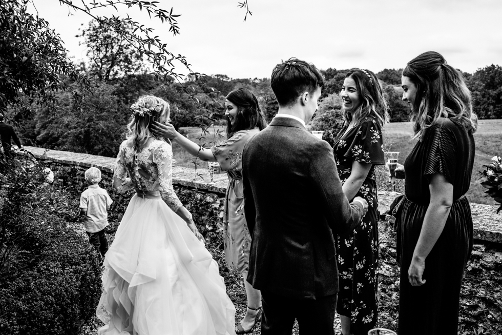 bride and groom saying hello to guests as they drink champagne
