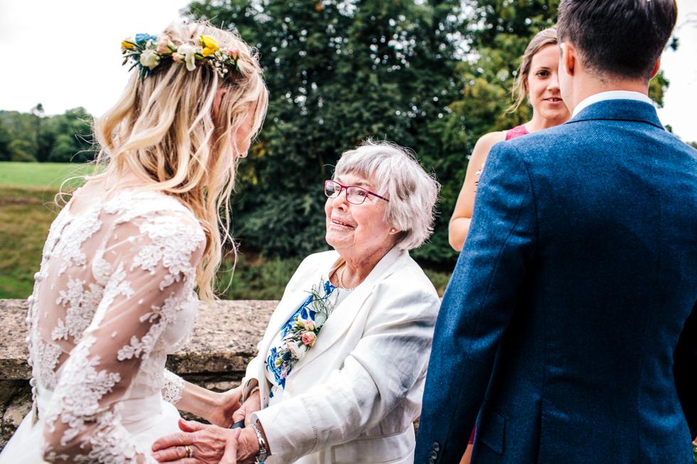 bride greeting nan at wedding reception