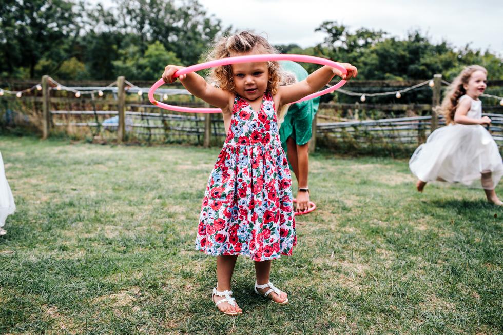 kids using hula hoops at wedding