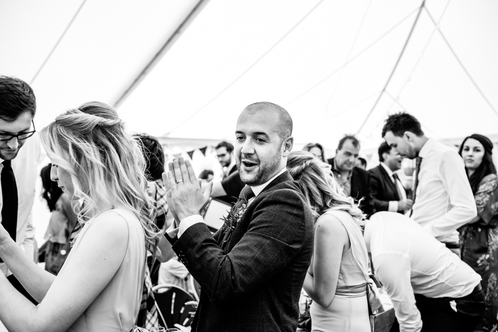 best man clapping and laughing at speeches