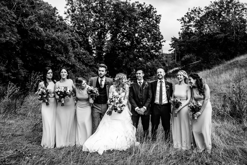 blue and orange stylised photo of smoke bomb with bride groom and friends at a wedding in Mells frome