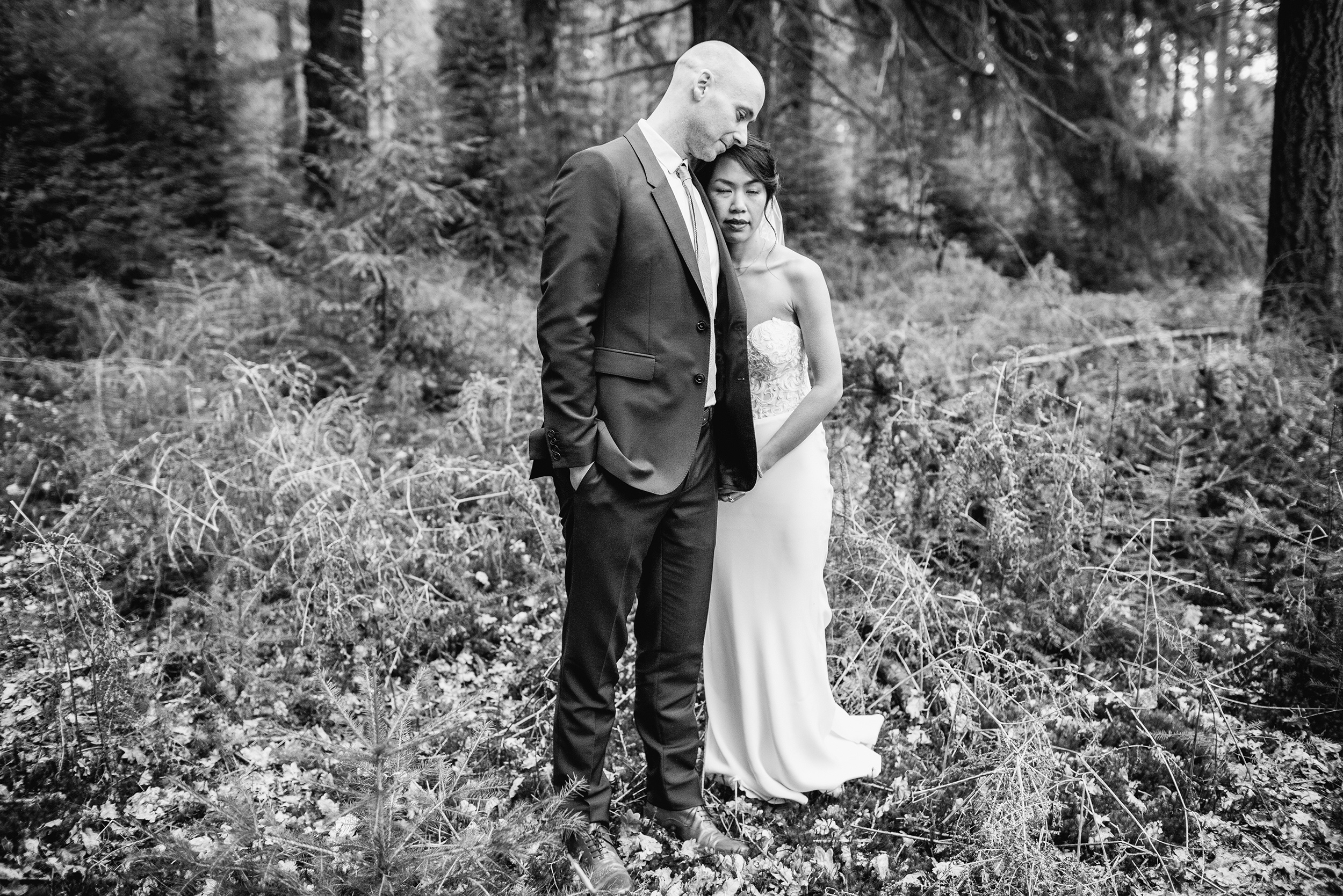 micro wedding couple standing in a forest in Bath together after getting married