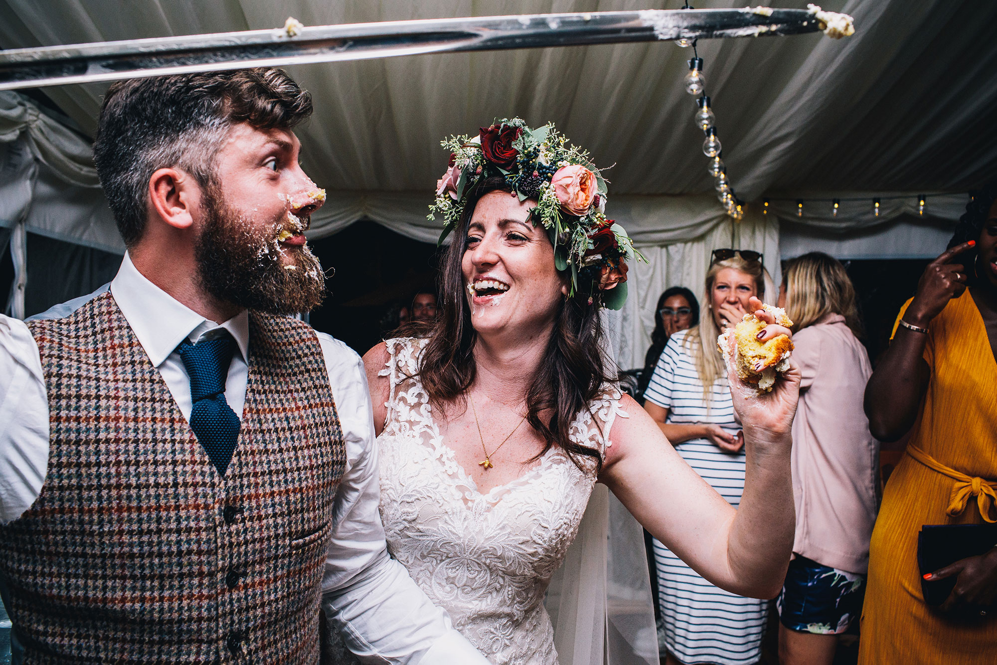 bride at owl pen manor shoving cake into grooms face which goes all over his beard