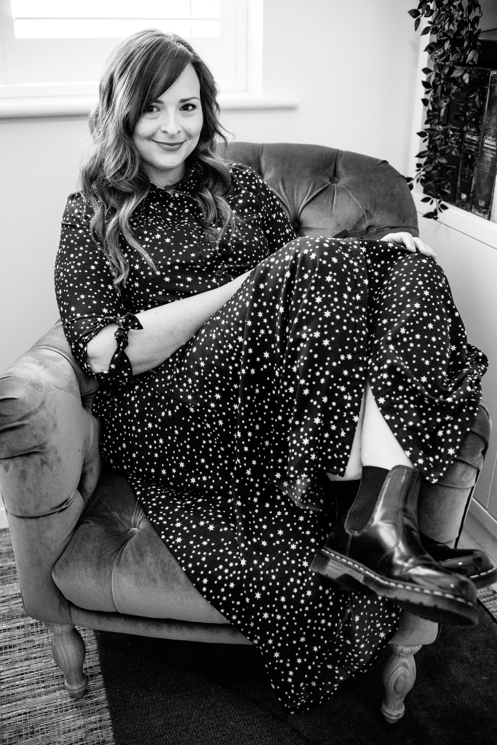 bath wedding photographer laid back in loaf armchair with doc martins on for headshot